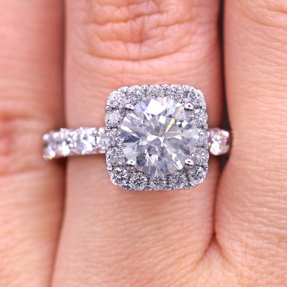 Dazzling round cut diamond ring with square halo