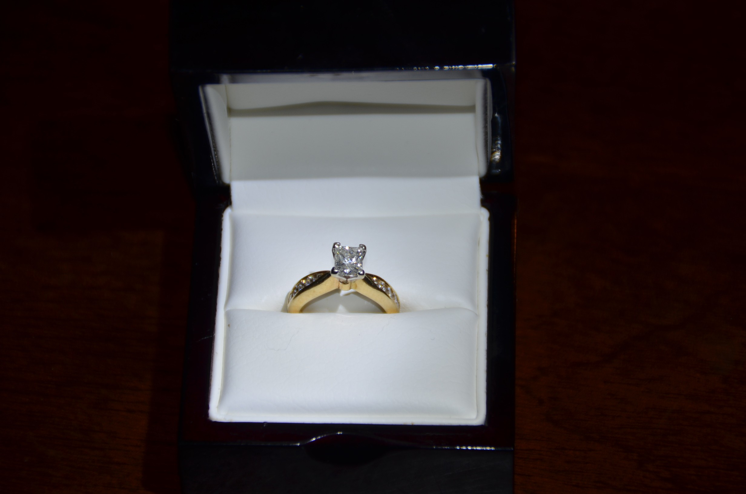 Princess cut 1 ct. center, 10 round accent stones in 14kt. yellow gold