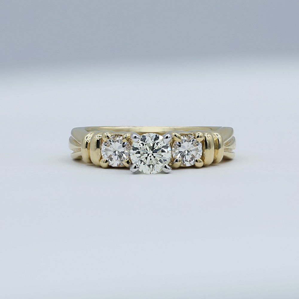 Three-Stone Yellow Gold Engagement Ring features center 0.50ct