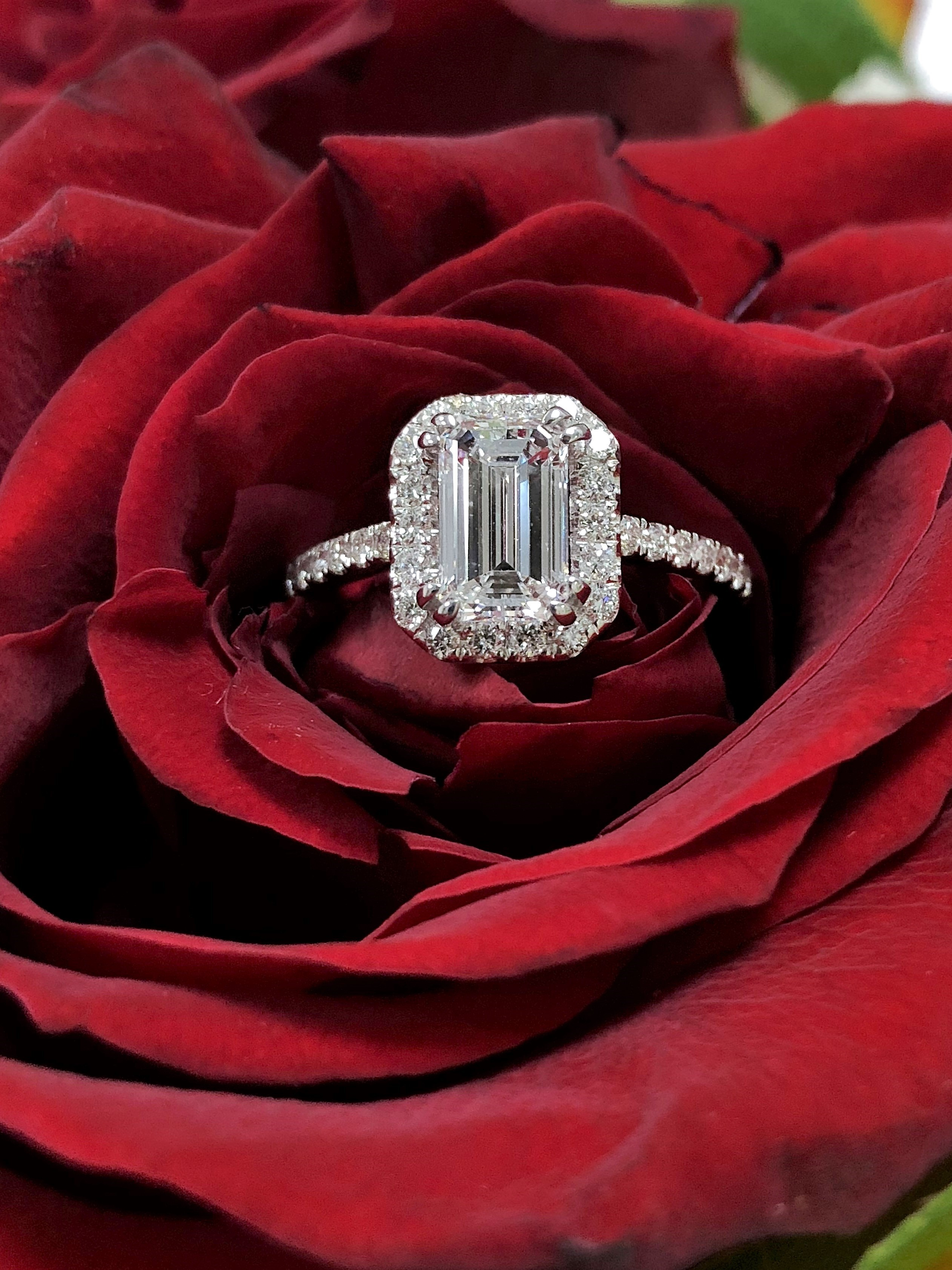 GIA certified 1.15 carat Halo Emerald cut diamond ring