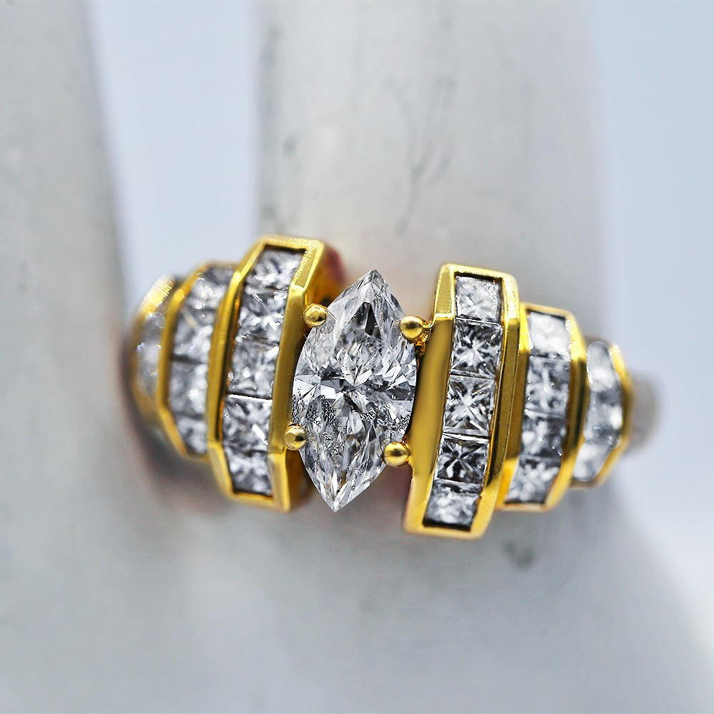 Yellow Gold Diamond Ring with center 1.00 ct Marquise Diamond
