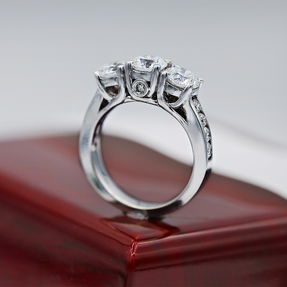 Dazzling Three-Stone Engagement ring features 3.00ct of round Diamonds
