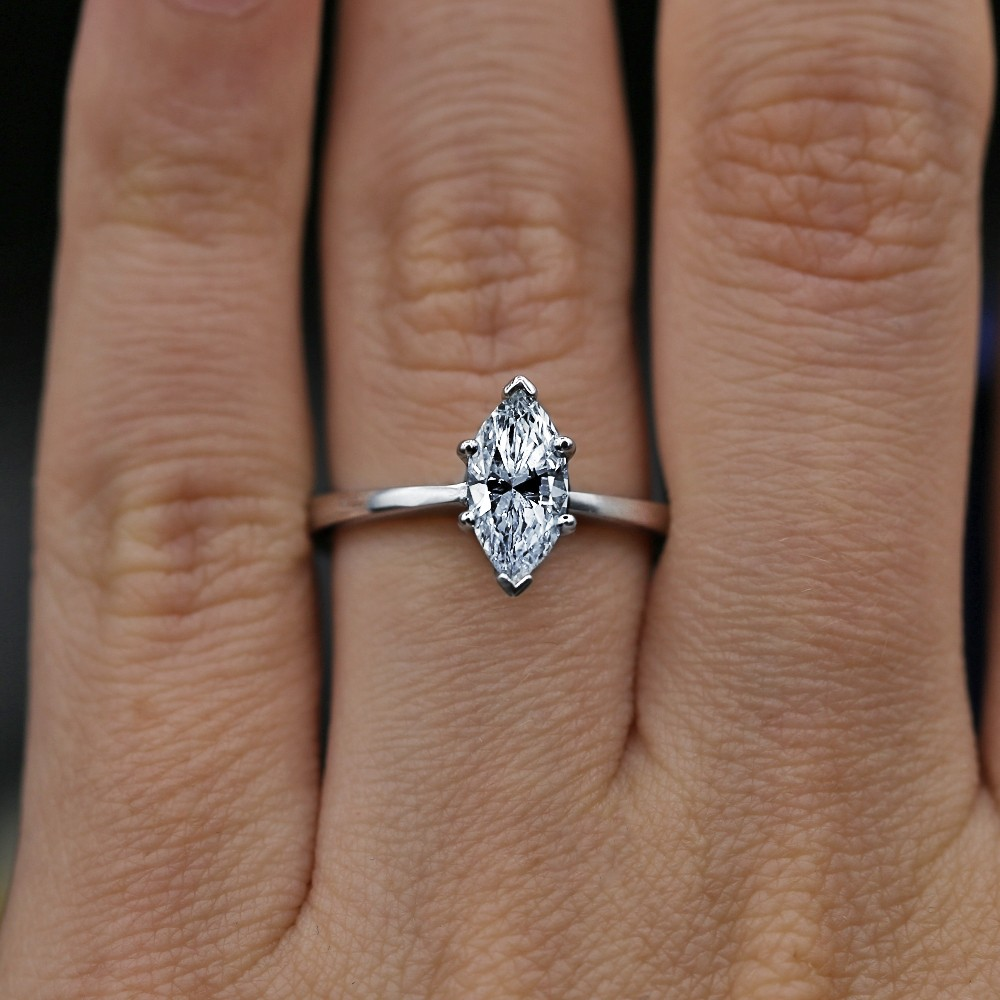 Exquisite 1.03ct Marquise Diamond Engagement ring crafted in 14k WG
