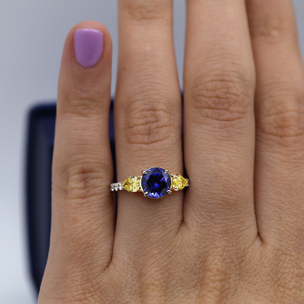 Engagement Ring with 2.00ct Center Blue Sapphire and two Fancy Yellow