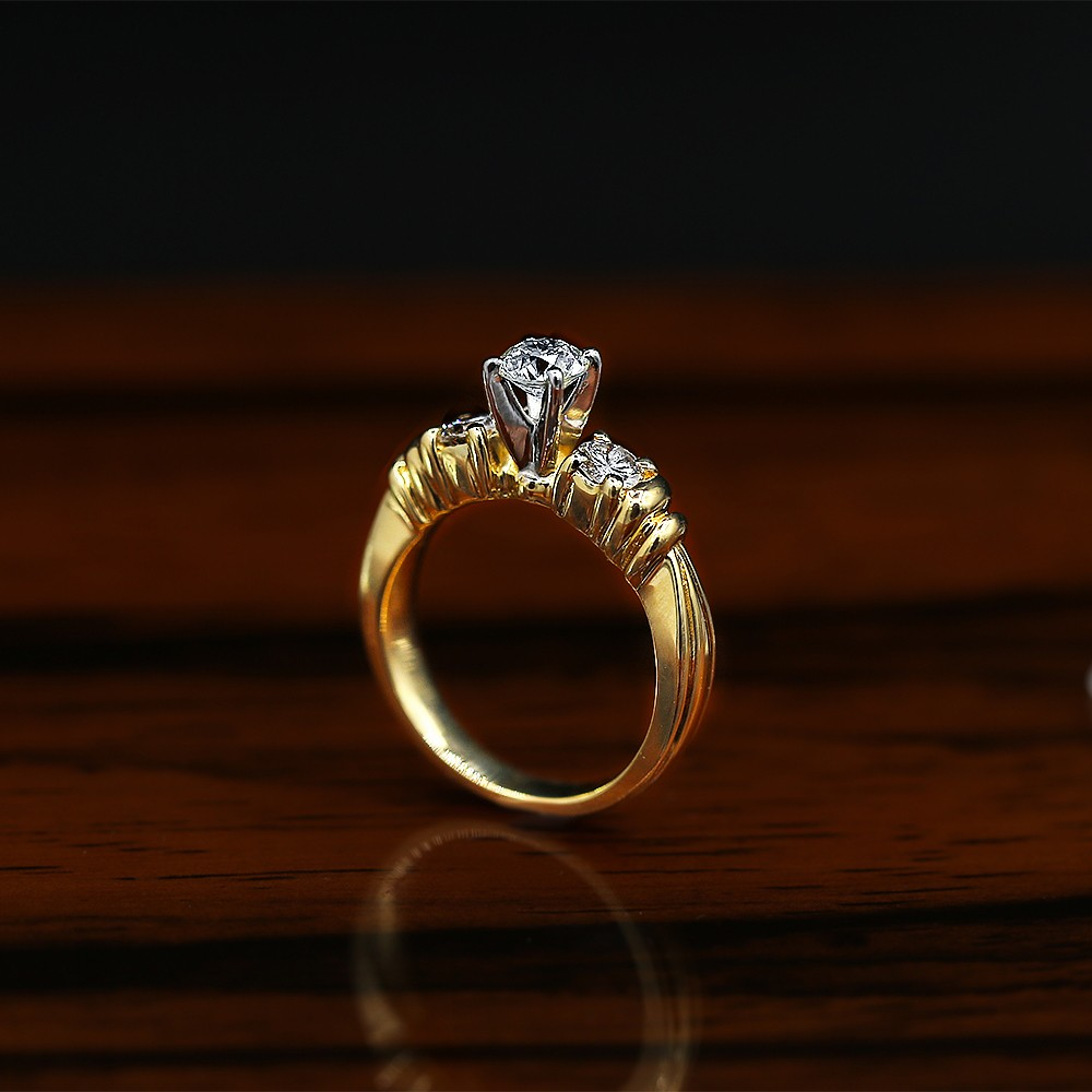 Classic Three-Stone Yellow Gold Engagement Ring features center 0.50ct