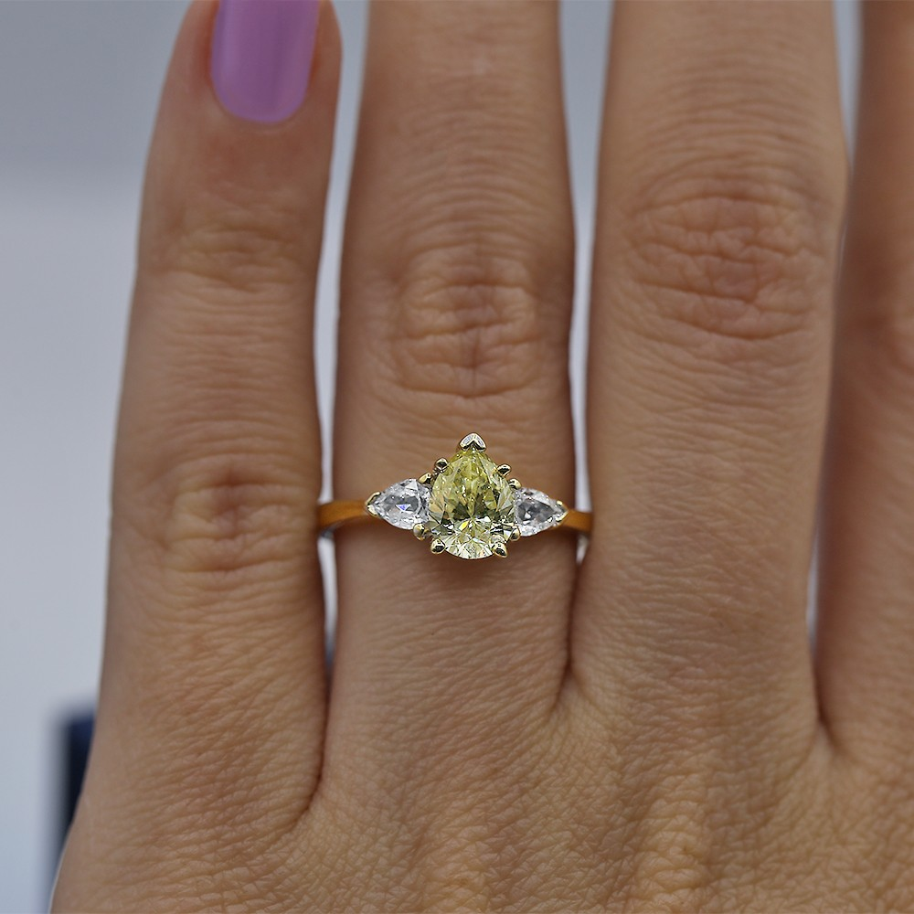 Engagement Ring with center Fancy Yellow and side White Diamonds