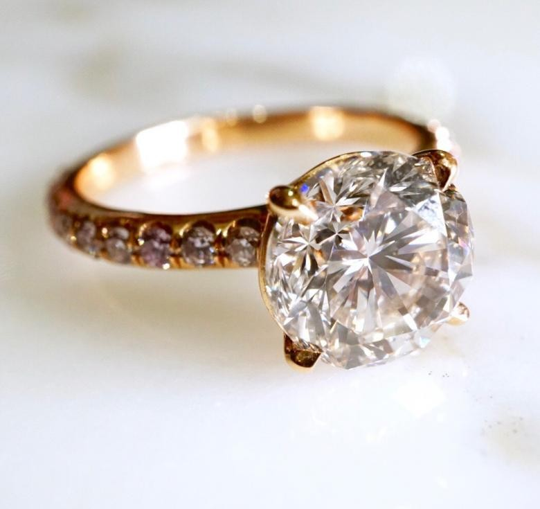 ROUND BRILLIANT ENGAGEMENT RING WITH FANCY PINK SIDE DIAMONDS - EGL