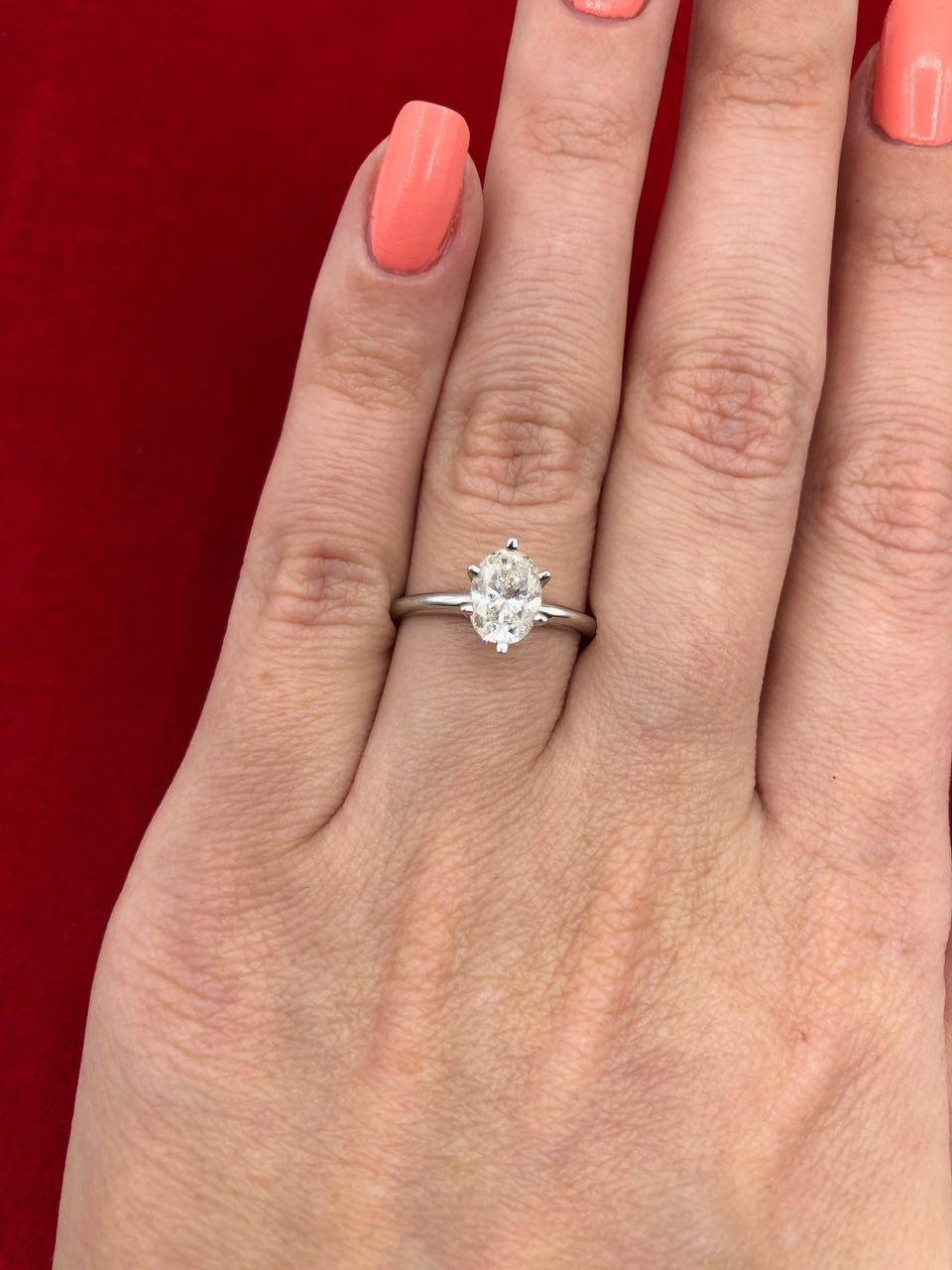 Engagement ring features 1.00ct center Oval Diamond