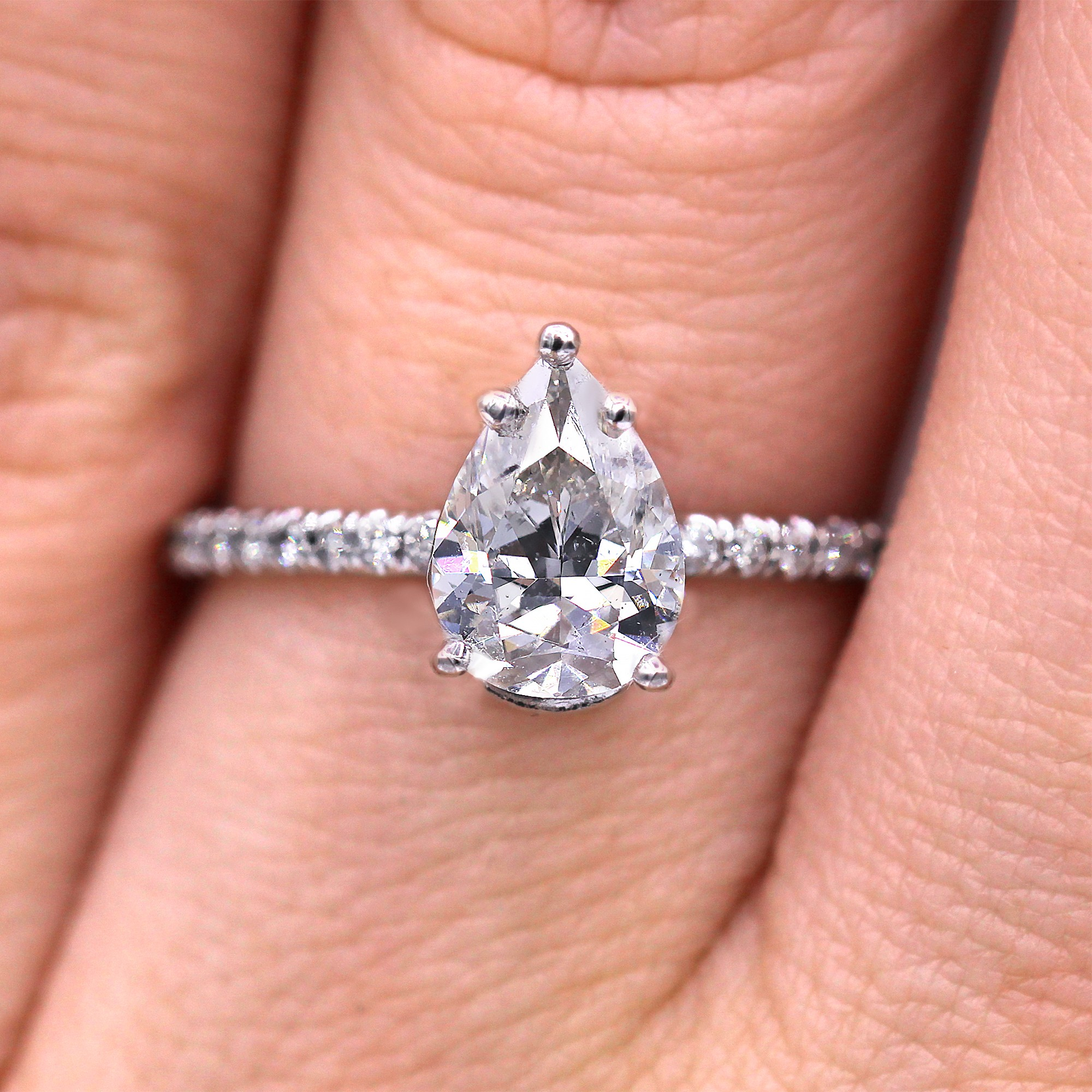 Petite and elegant pear cut diamond ring. GIA certified
