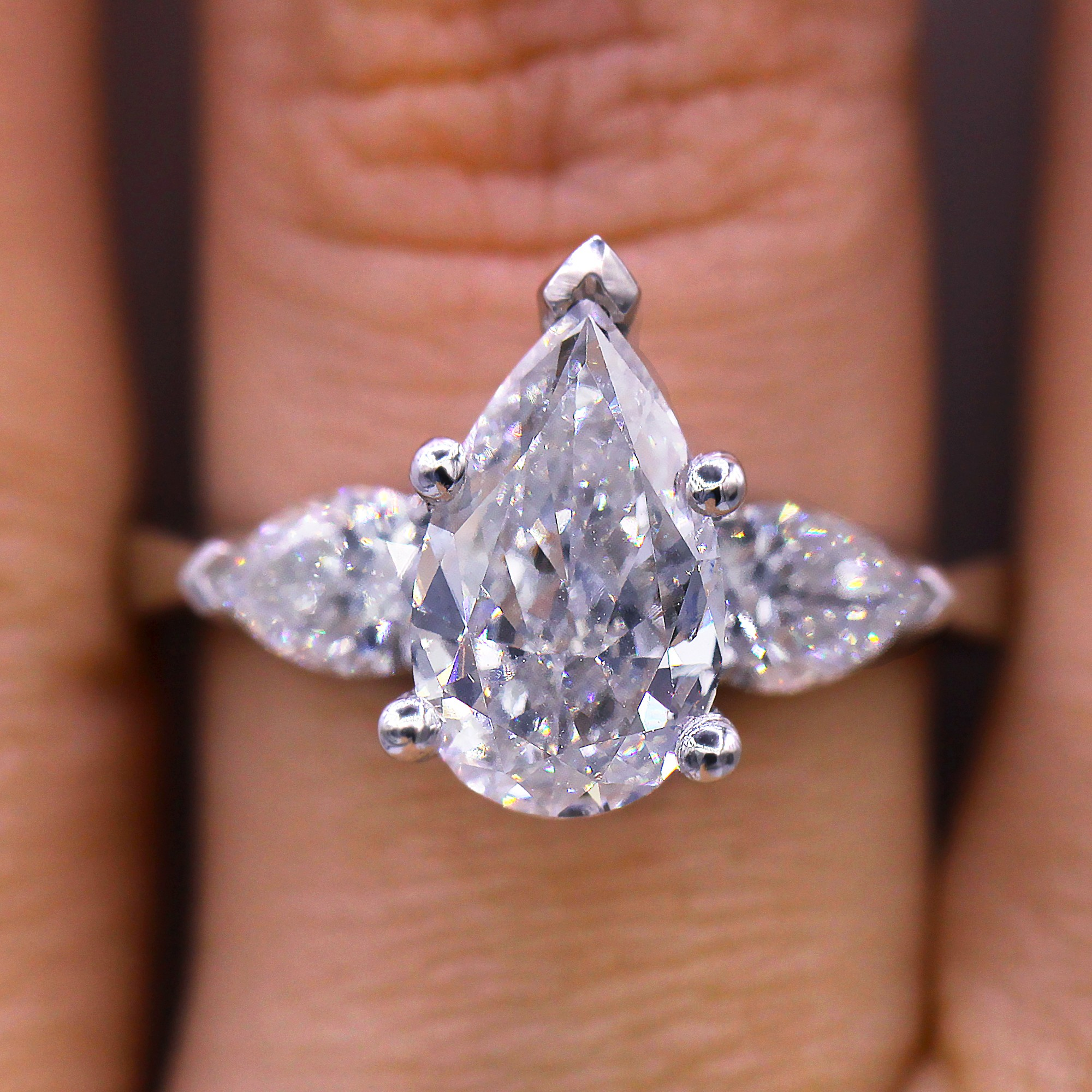 Unique pear shaped diamond ring