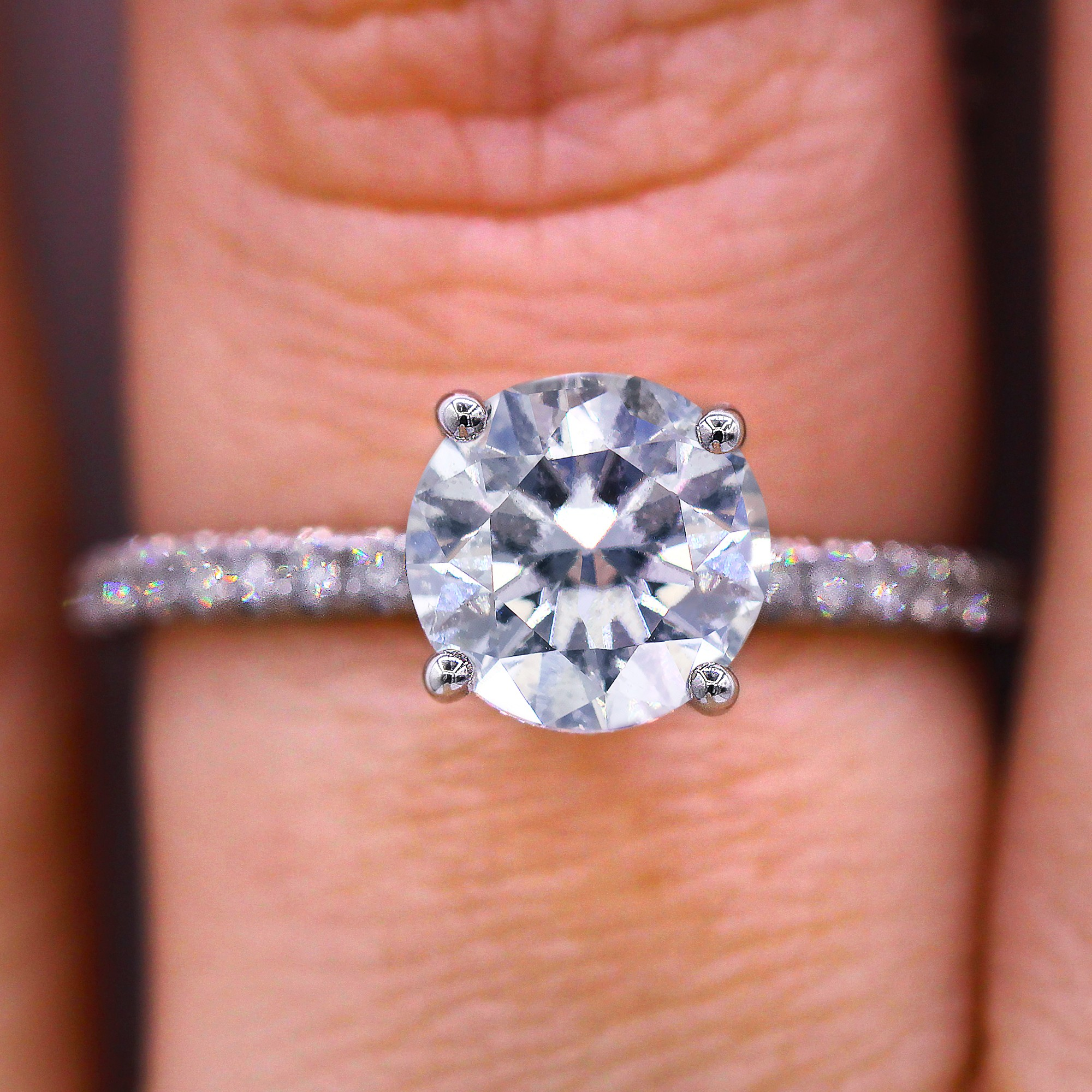 French Pave set round cut diamond ring