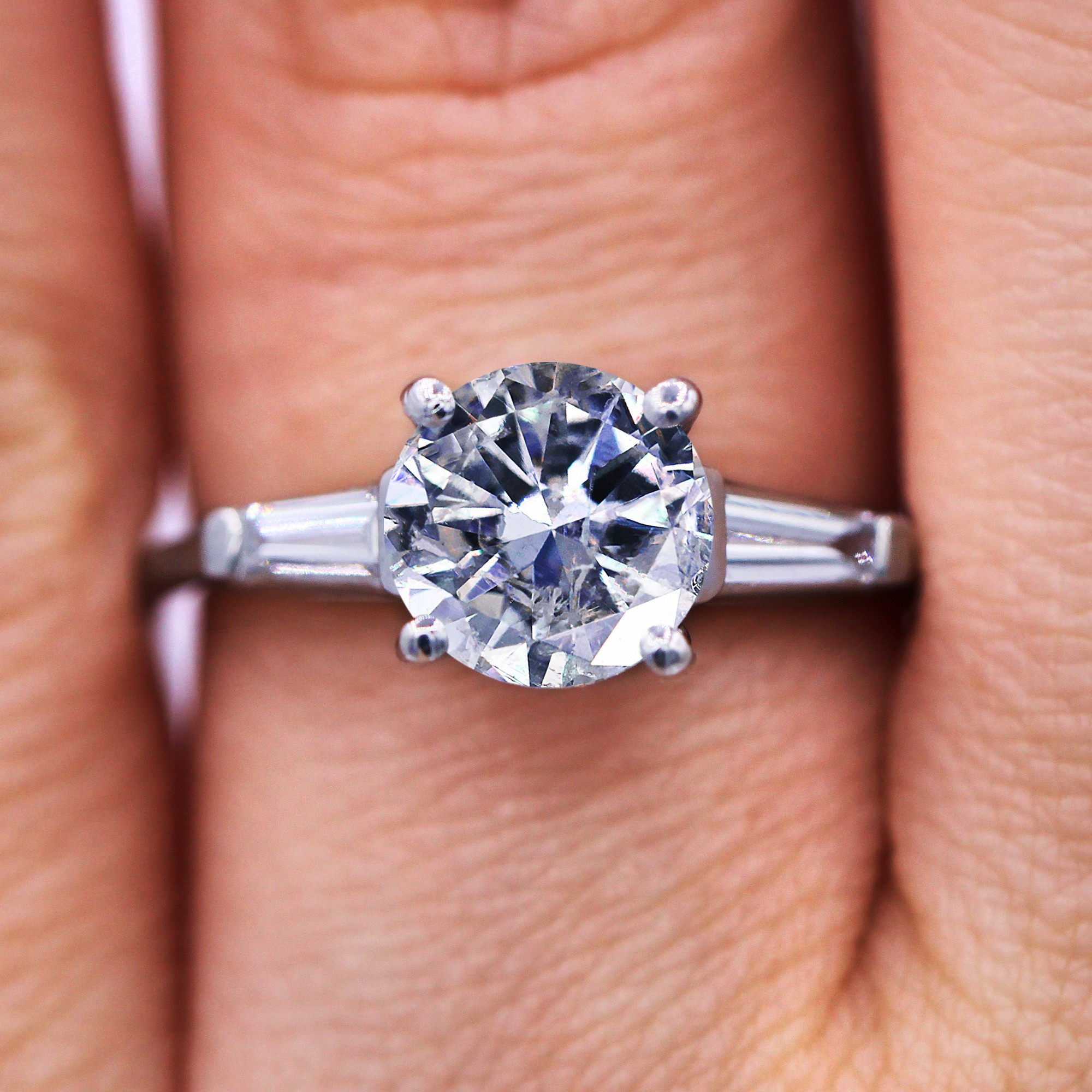 1.54 Ct Round and Baguette three-stone diamond engagement ring