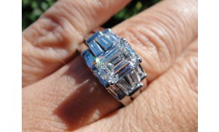Emerald cut  GIA 1.50 H vs2 Cntr in a Platinum set with 2 bands